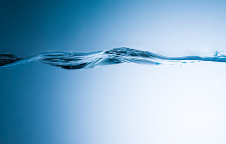 Blue background. Abstract water wave with bubbles.