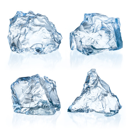 ice water: Pieces of ice on a white background. Stock Photo