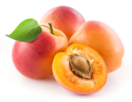 apricot kernel: Apricots with leaf isolated on white