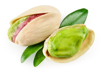 Pistachio with leaves, isolated on white background