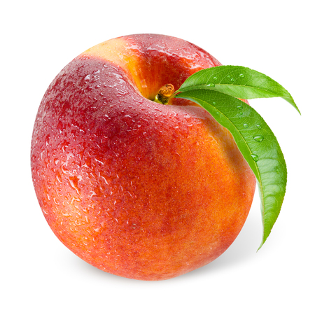 Peach. Wet fruit with leaf isolated on white