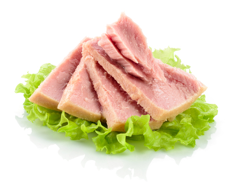 prepared dish: Tuna. Canned fish on green lettuce leaf