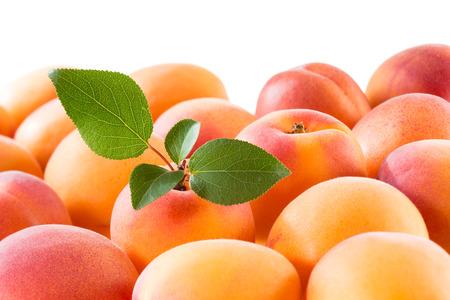 fruit background: Apricot with leaf. Fruit background