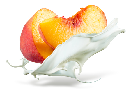 Peach is falling into milk. Splash isolated on white background