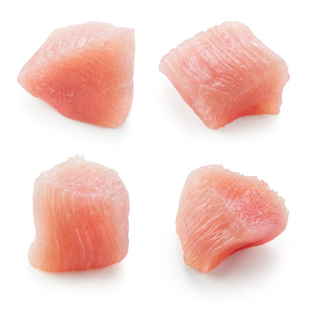 Raw chicken fillet. Small pieces of meat isolated on white. Collection. Foto de archivo