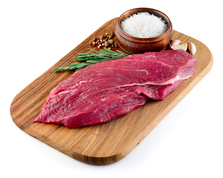 Slice of raw beef steak isolated on white. With clipping path.