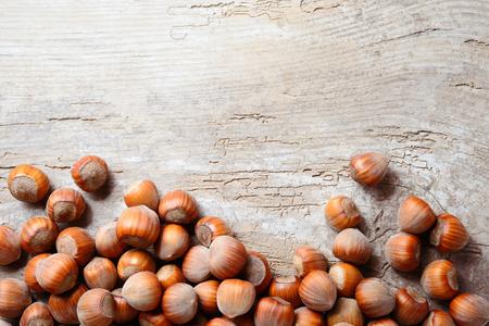 Hazelnut. Fresh organic filbert. Nuts on wooden background.