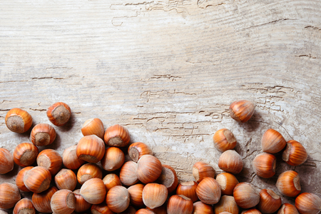 Hazelnut. Fresh organic filbert. Nuts on wooden background.