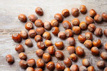 Hazelnut. Fresh organic filbert on wooden background. Nuts macro.