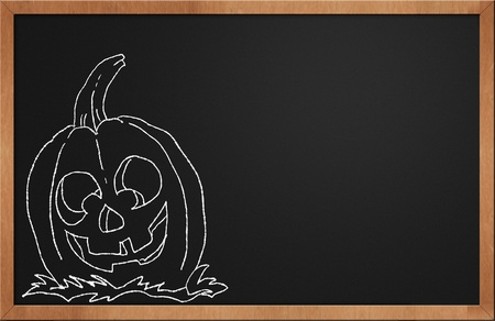Halloween Pumpkin smiling on a black chalkboard Stock Photo