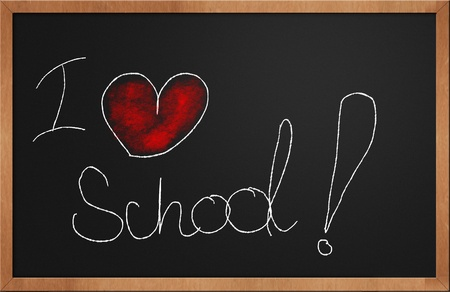 I love school written with chalk and red colored heart on a blackboard