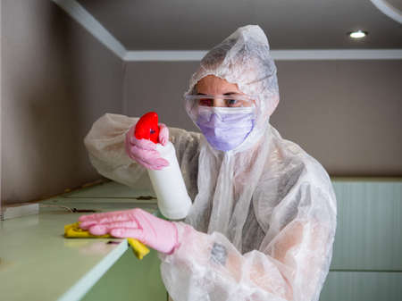 The orderly disinfects the premises with a disinfectant. Coronavirus, COVID-19 prevention concept.