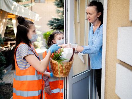 Teenage girls volunteer to deliver food to poor people.