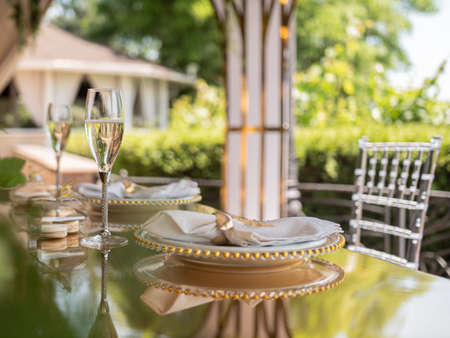 Elite table setting in an expensive outdoor restaurant. Glasses of champagne waiting for the guests of honor.