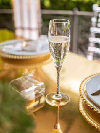 Close-up of a glass of elite champagne on a beautifully decorated festive table in a luxury restaurant. Stok Fotoğraf