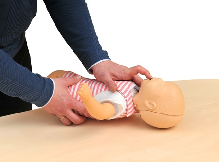 first aid instructor using infant dummy Standard-Bild