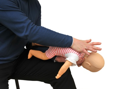 First aid instructor using infant dummy