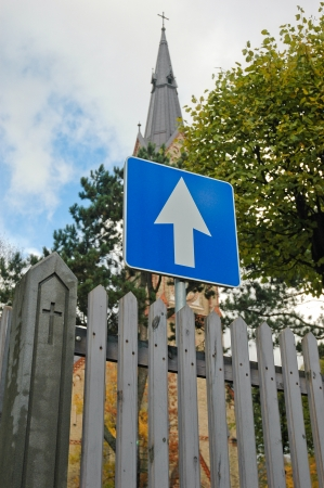 one way sign near church photo