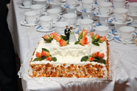 wedding cake with groom and bride photo
