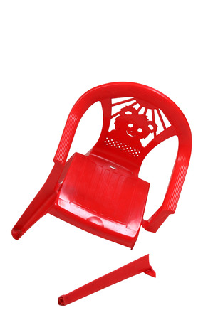 red chair: plastics chair with broken leg on white background