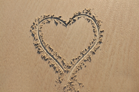A heart shape drawn in the sand photo