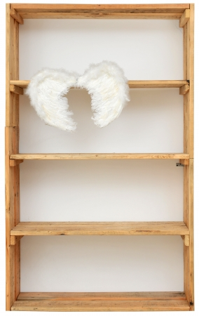 Angel wings in shelf photo