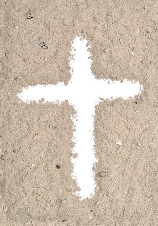 White cross in ash Stock Photo