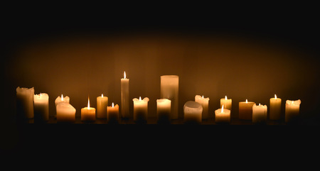 warming therapy: Candles in dark Stock Photo