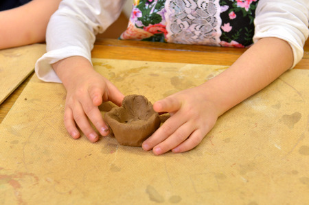 Clay in child hands photo