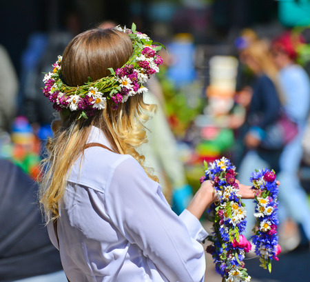 latvia girls: Young woman with clover crown ; Traditional latvian events Ligo