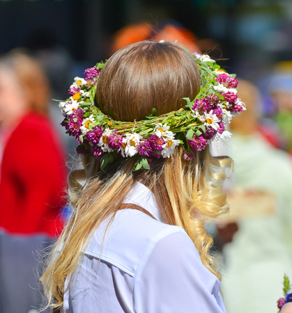 latvia girls: Young woman with clover crown Stock Photo