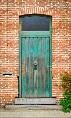 abrasion: Green wooden front door with abrasion