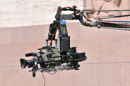 Camera crane in action Stock Photo
