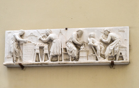 craft on marble: Stone sculpture scene on wall. Italy, Firenze.