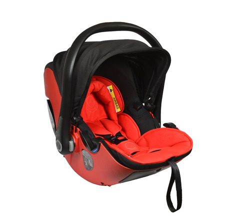 Red baby car seat isolated