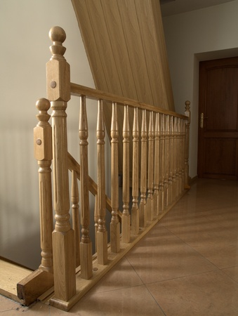 The wooden balustrade in room photo