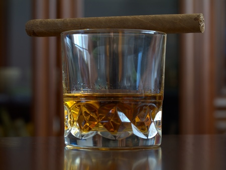 savour: The whisky in glass and cigar on table Stock Photo