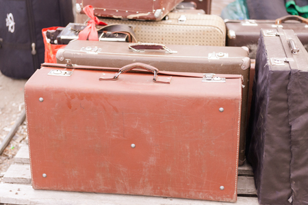 Flea market. Sale of old things. Old suitcase. Worn leather case.