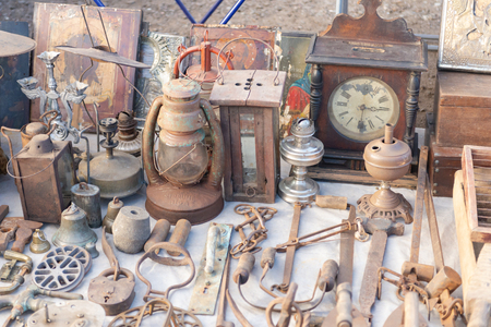 Flea market. Sale of old things. Novice antique dealer.