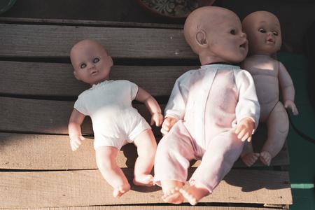 Flea market. Sale of old things. Dolls fell asleep in the market.