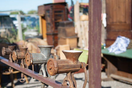 Flea market. Sale of old things. Meat grinders of our ancestors. Rusty kitchen utensils.