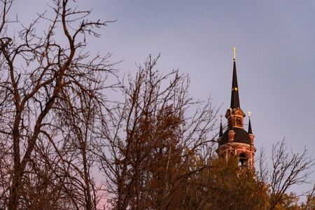 Gothic Orthodox Cathedral. Neo-Gothic Orthodox Church with Masonic symbols. Church spire against the blue sky. Stock Photo