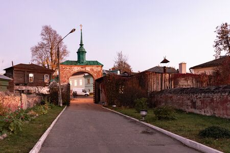 Gate to Mozhaisk Kremlin. The gates of the old town at sunset. Mozjajsk the Kremlin from the bridge
