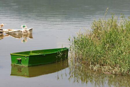 Zywieckie lake. A broken sunken boat. Boats on a lake in Poland.