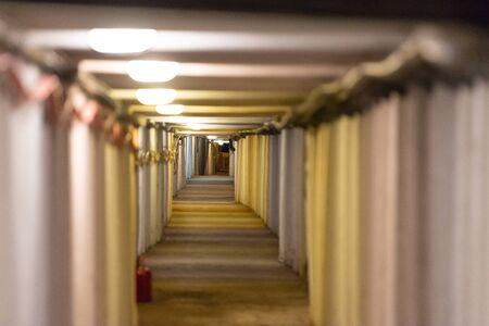 Salt caves near Krakow. Underground corridor with support beams. Stock Photo