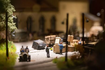 The layout of the city. Miniature model of unloading area with figures of people.