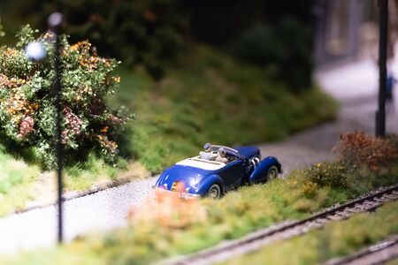 The layout of the city. Convertible model next to the railway tracks. 免版税图像
