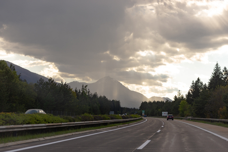 Roads Of Austria. Austrian highway with beautiful views. Wet road after rain. Photo from the car.