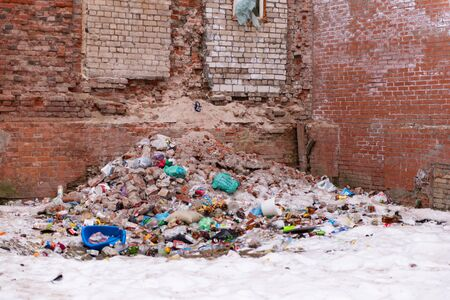 Tver. Quarter of old houses. Morozov barracks. Dump at the wall of the house. Stock Photo