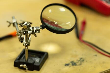 Magnifier. Tool for precise soldering. Magnifying glass in the electronics repair shop. Stok Fotoğraf